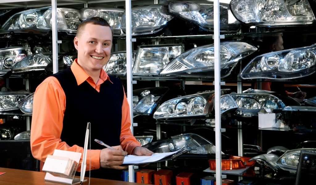 Smiling auto parts salesman