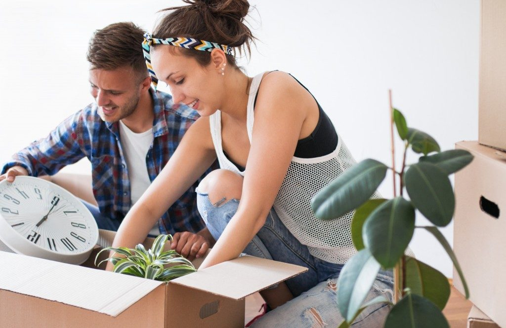 couple unpacking their things in their new apartment