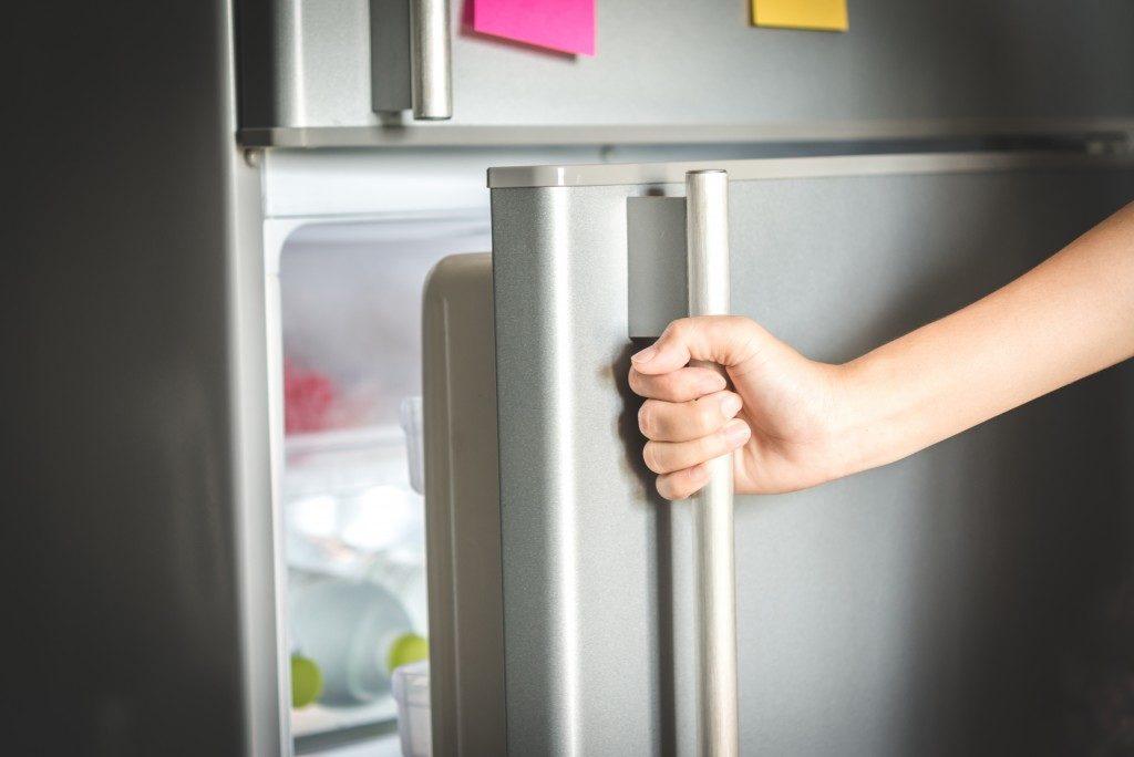 closeup of refrigerator being opened