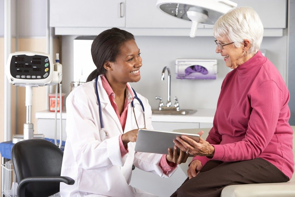 Doctor discussing records with female patient
