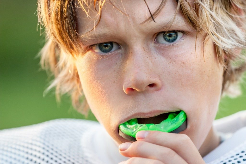 Kid wearing mouthguard