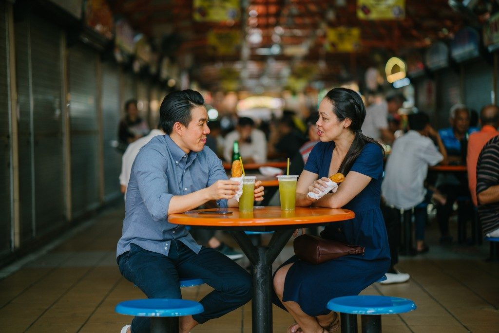 Asian couple enjoying a snack at a restaurant