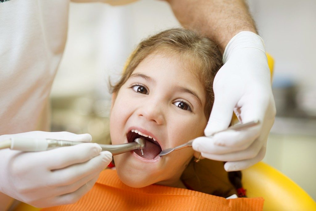 kid at dental clinic
