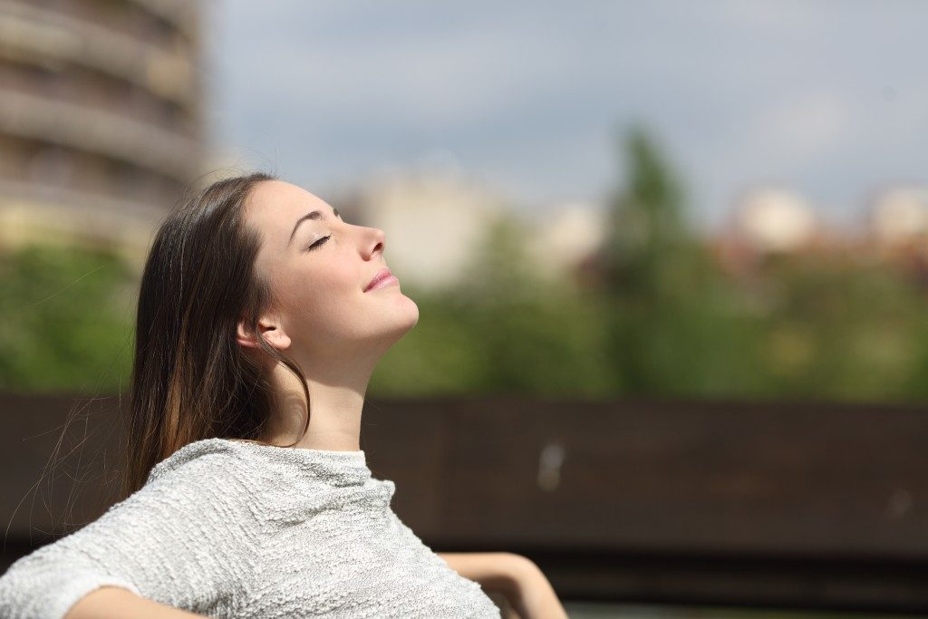Girl breathing fresh air