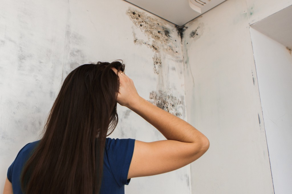 woman looking at her dirty walls