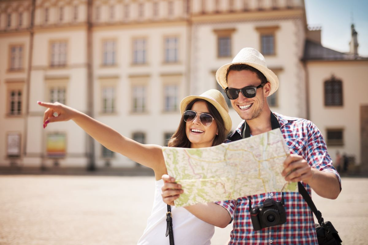 tourists holding a map and pointing