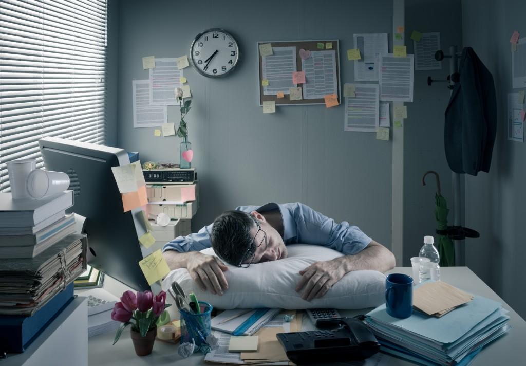 man feeling overworked