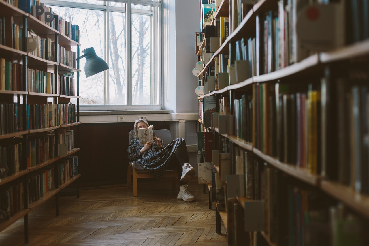 woman sitting in chair in the library