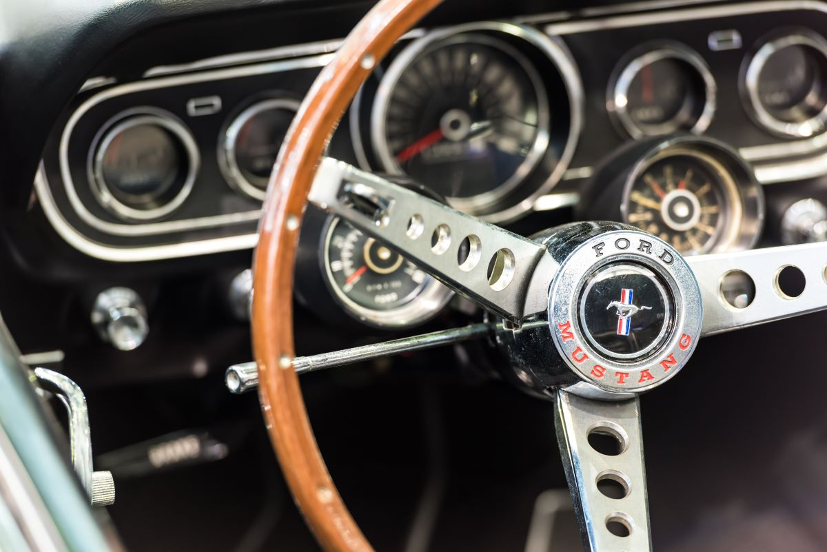 classic ford mustang steering wheel and gauge panel