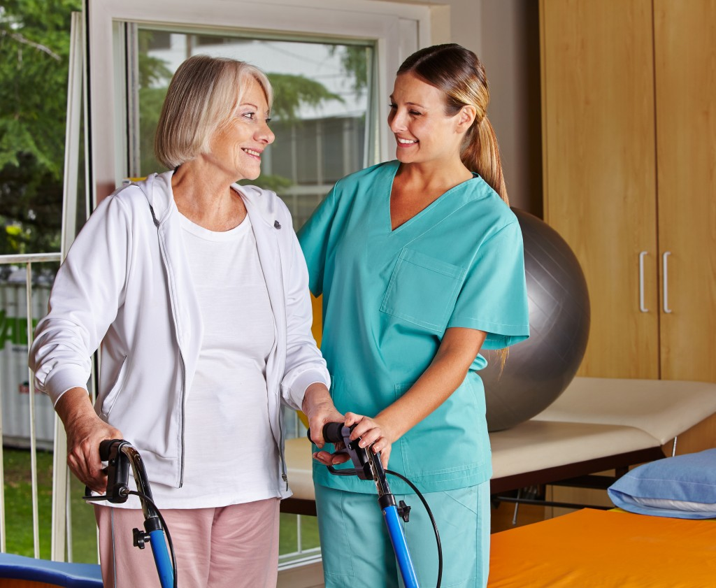 Nurse assisting elderly woman