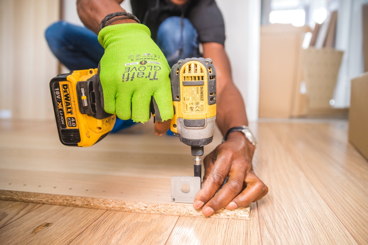 man drilling a home