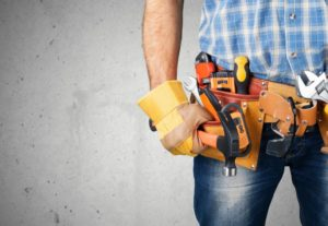 man with belt bag full of tools
