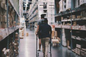 2 men inside warehouse