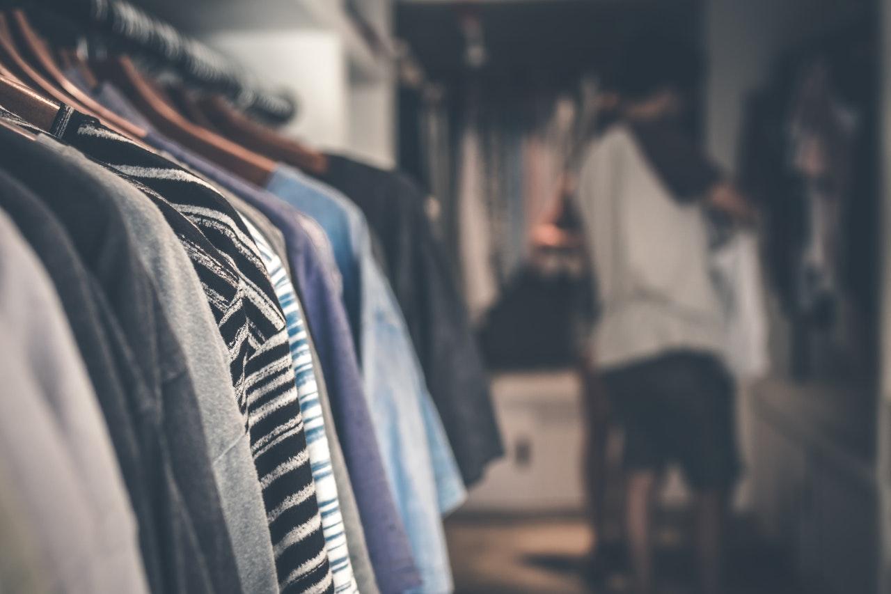 man and closet