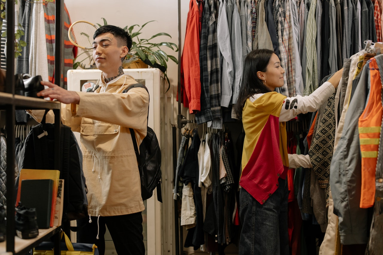 man and woman shopping for clothes