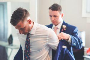 a groom getting dressed