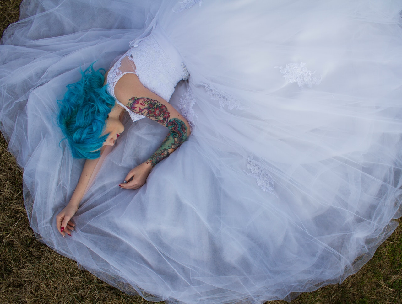 bride with blue hair laying down