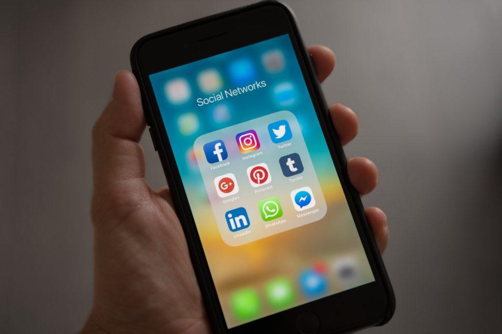 social media platform icons on a phone