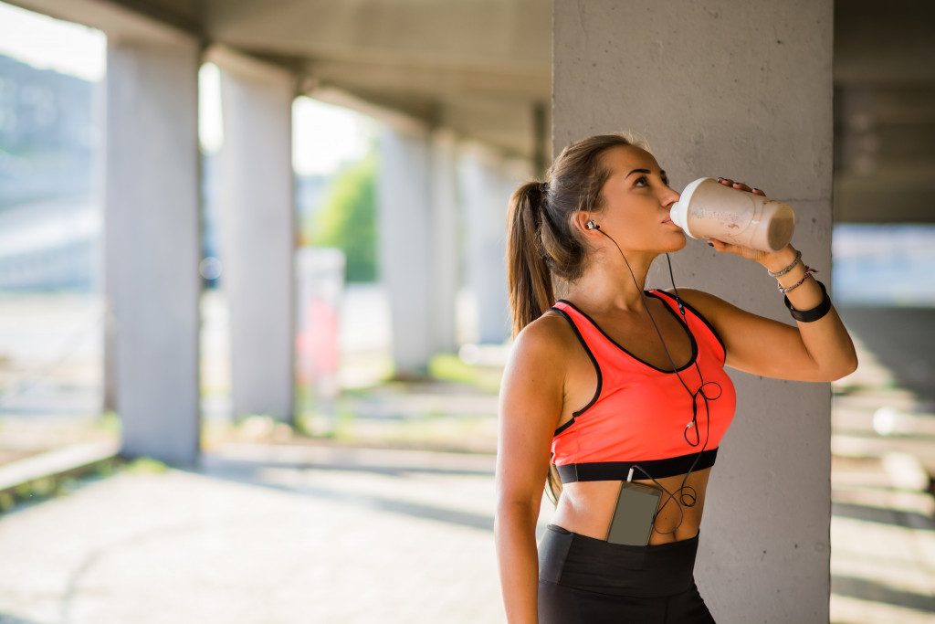 drinking protein shake after a jog
